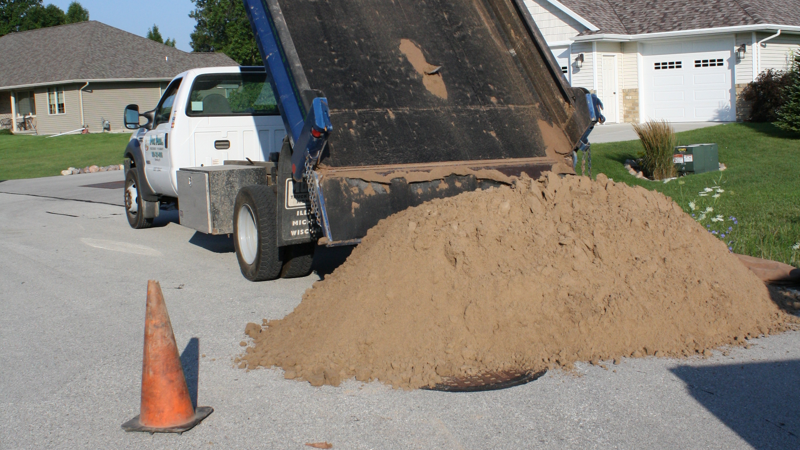 Now we unload the washed mason sand that we provide and brin to the site.