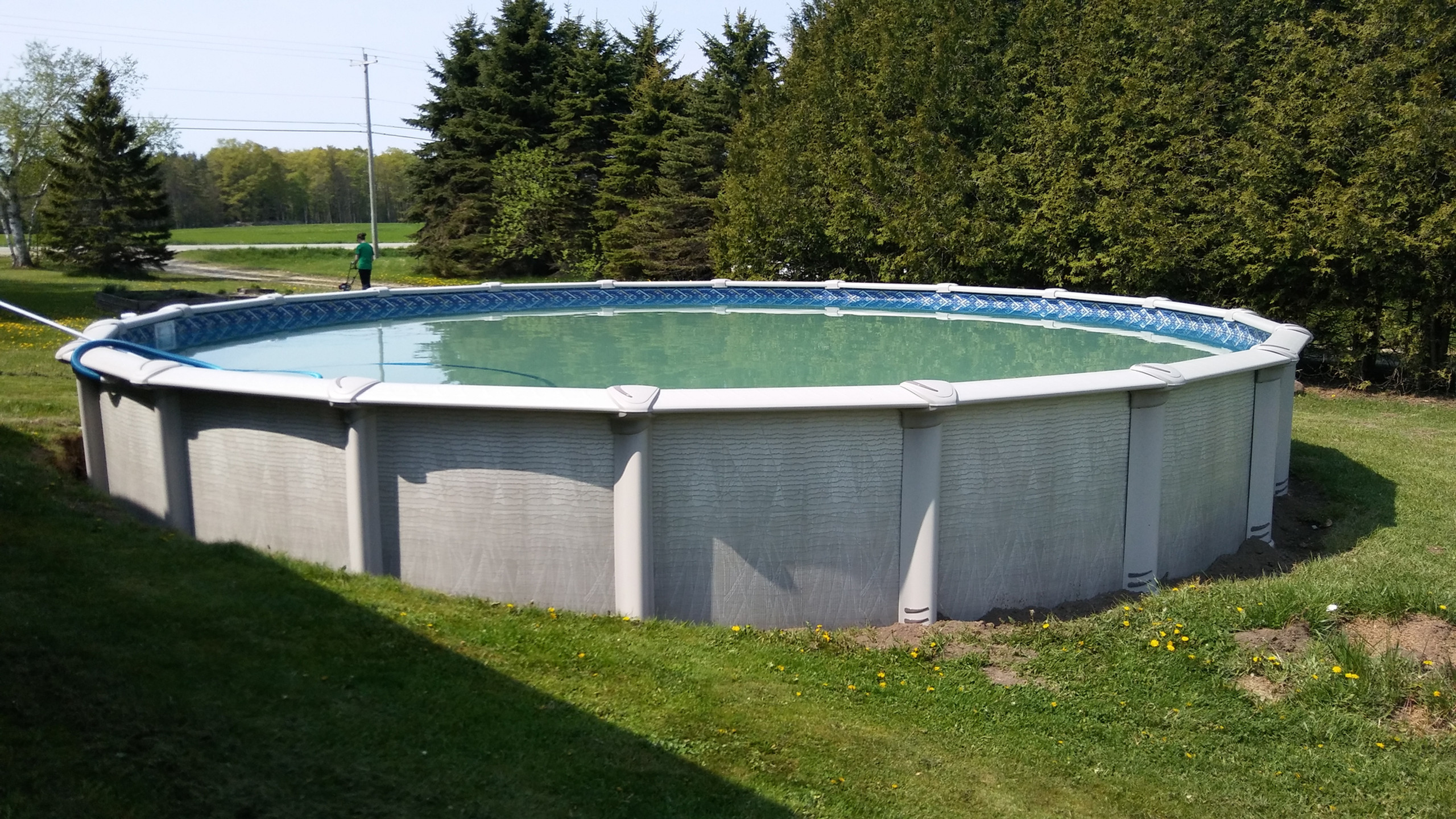 This 30' Evolution Above Ground Pool by Pool Pros was built in Sturgeon Bay, WI.