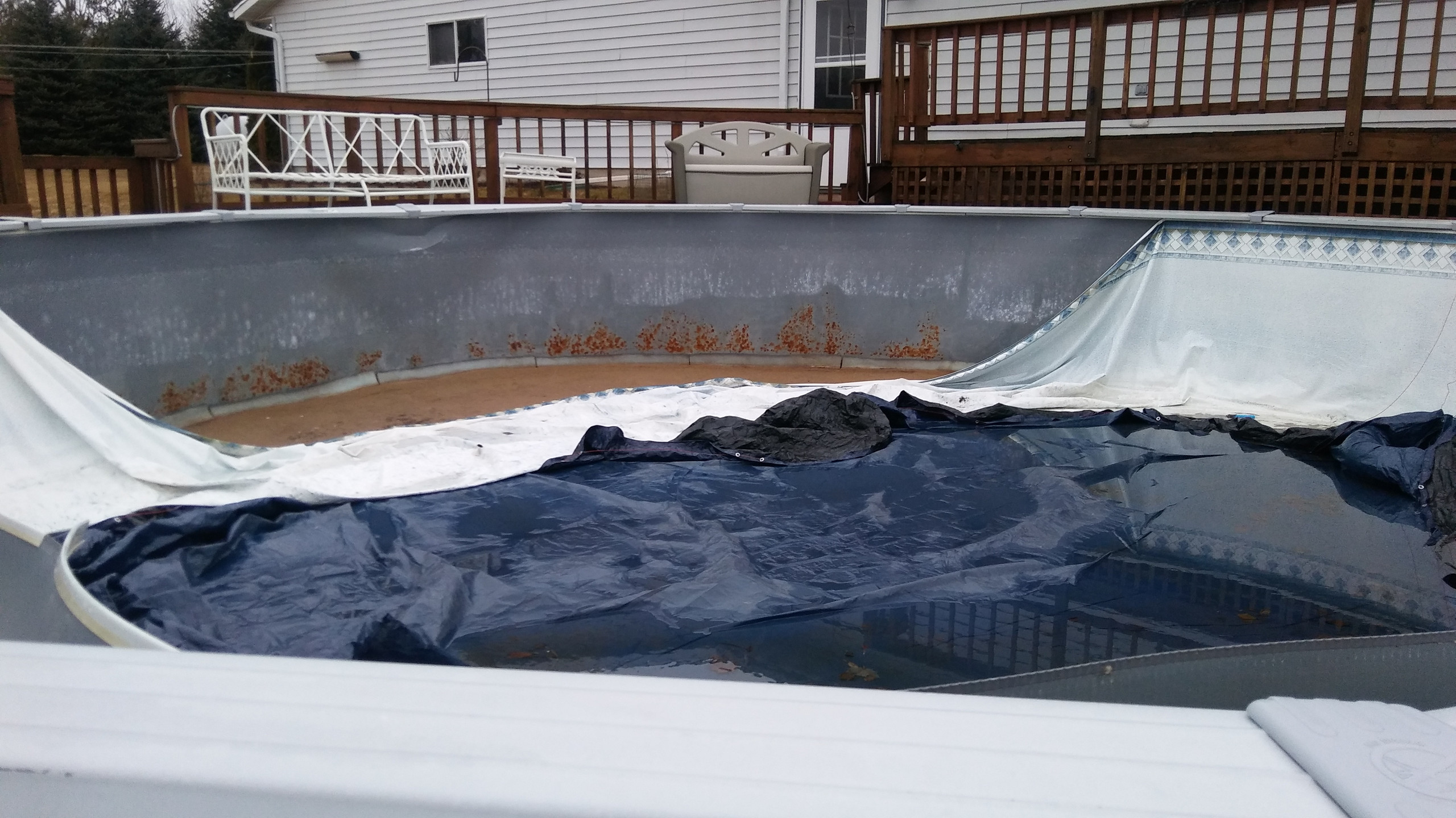 This above ground pool was damaged by patio blocks used during the installation process.