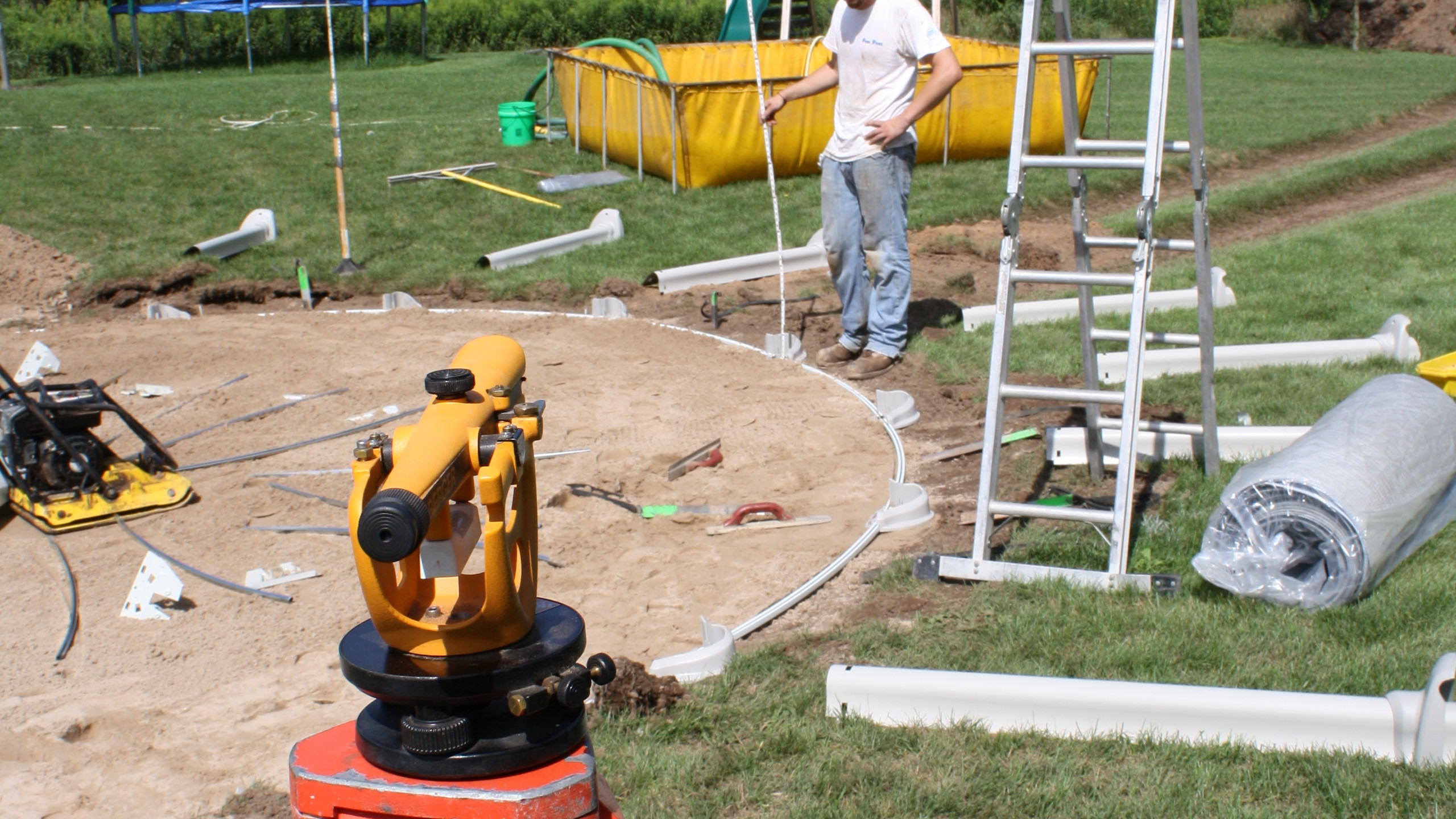 """After the pool is rounded, the sand base installed and the parts staged, we double check the levelness of the bottom track to ensure we are still within our 1/8"""" tolerance."""