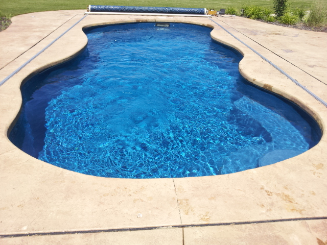 APSP Gold Award for Residential Fiberglass Pool with extensive retaining walls and pondless waterfall.