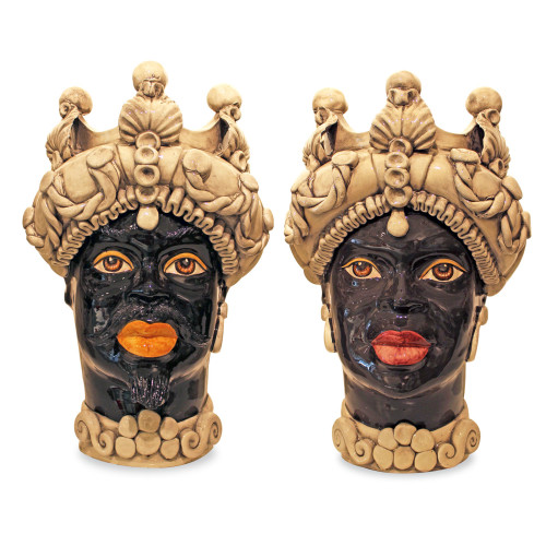 A pair of Traditional dark-skinned 'Teste di Moro' ceramic Moor's head from Sicily