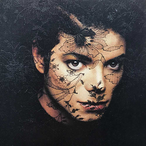 Iconic photograph of pop superstar Michael Jackson peering through a black lace veil