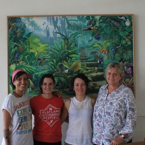 Artist Deirdre Hyde (far right) poses in front of her painting of Wilson Botanical Garden at the Las Cruces Biological Station in Costa Rica