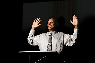 Speaker with Hands Raised