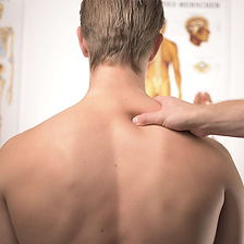 Physiotherapist treating neck a d shoulders