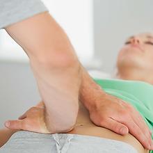 Physiothrapist checking pelvic alignment