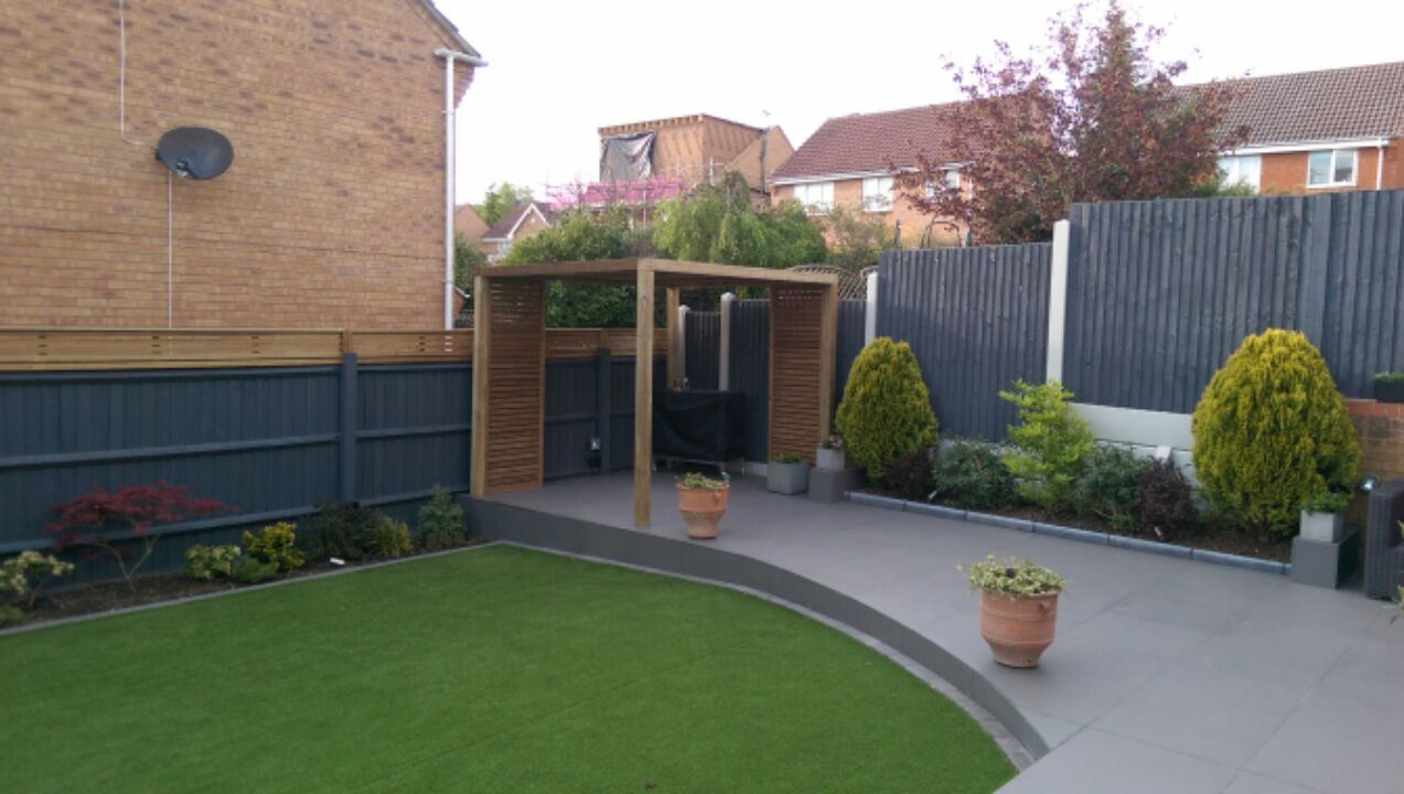 Pergola with slatted panels