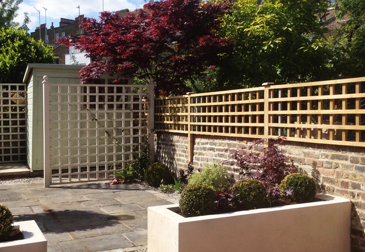 Wall top trellis fencing at Aylwards