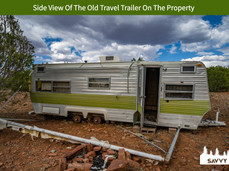 Side View Of The Old Travel Trailer On The Property.jpeg
