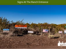 Signs At The Ranch Entrance.png