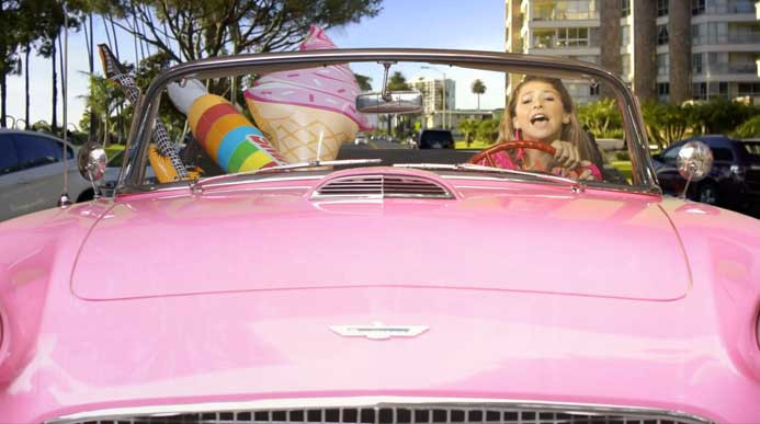 Stella rockin' the convertible!