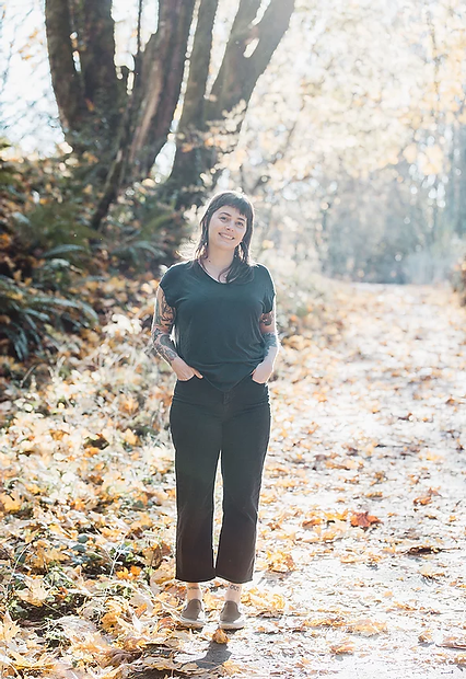 Photo of Dani Allen on a path with trees