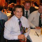 Tom Claxton with his award for the most improved player of the year