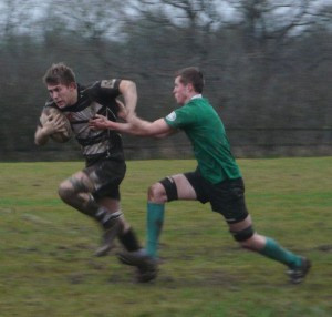 Josh Bull goes in for the tackle