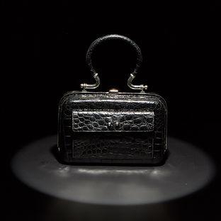 A Mid-20th Century Structured Black Baby Crocodile Handbag