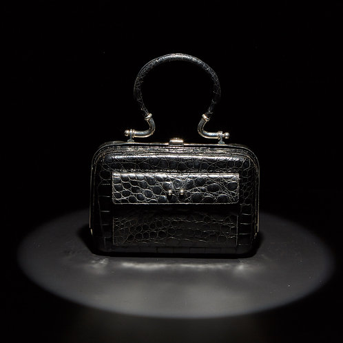 A Mid-20th Century Structured Black Baby Crocodile Handbag