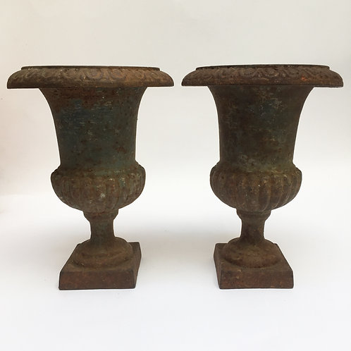 A Pair Of French Iron Urns
