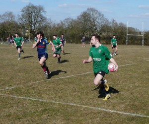 Elis Garland on his way to scoring his second try for Minety on Saturday