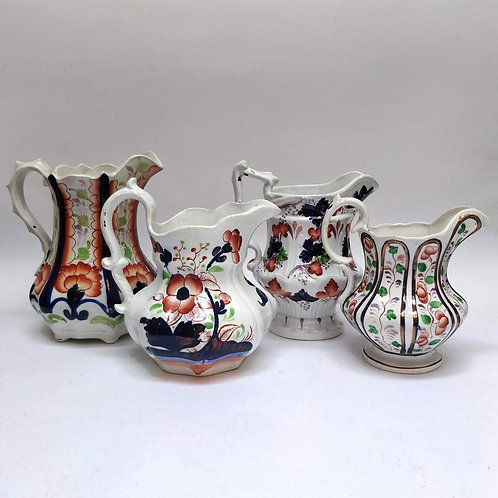 A Set Of four 'Gaudy Welsh' Jugs