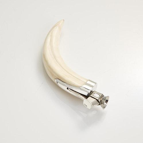 An Antique Boar's Tusk Cigar Cutter