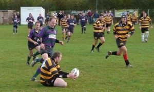 057 Combe Down player goes down with the ball