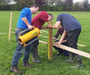Putting up the fence round the rugby pitch
