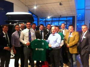 Former Bath & England scrumhalf Richard Hill presents T H White sponsored kit to Minety players