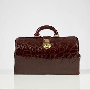A Wine Colour Crocodile Gladstone Bag Complete with Original Key