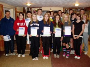 Players from the Minety Rugby Academy receive their Rugby Ready Certificates from RFU Coach Educator Neil Loader