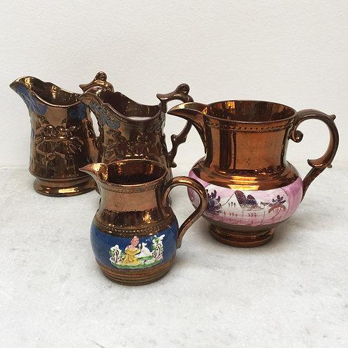 Set Of Four 19th Century Copper Lustre Jugs