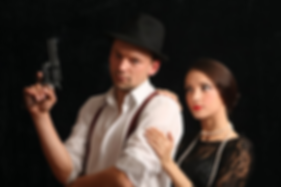 1920's Detective with revolver with damsel in distress