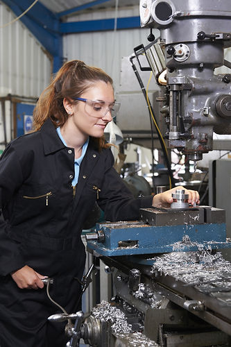 Female Apprentice Engineer Working On Dr