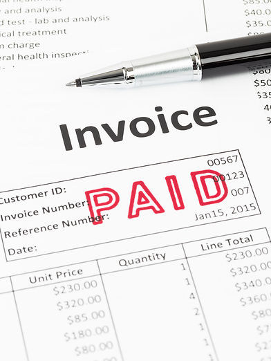 Invoice and pen with paid stamp; documen