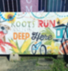 "Picture of sign that says: ""Roots run deep here"""