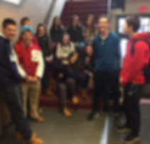 Picture of Spaulding HS students posing on stairs in the high school.