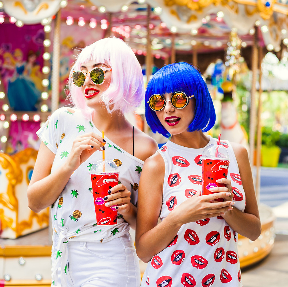 Dressed-up girls in colorful wigs at a costume party event in barcelona