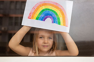 Kid painting rainbow during Covid-19 qua