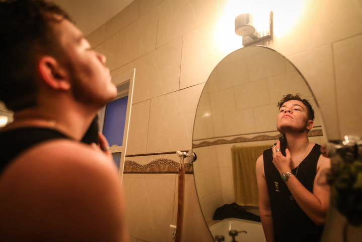 Niko Storment shaves in his San Francisco home before he begins his night on Monday, May 13. (Photo: Adelyna Tirado)