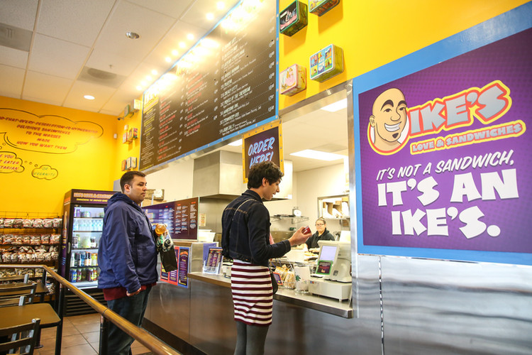 Matt pays for a sandwich at Ike's Sandwiches in Daly City, Calif. on Mar. 10.   Strege was primarily afraid to wear feminine clothing outside of his house in the fear of being judged, but decided to try. (Photo: Adelyna Tirado)