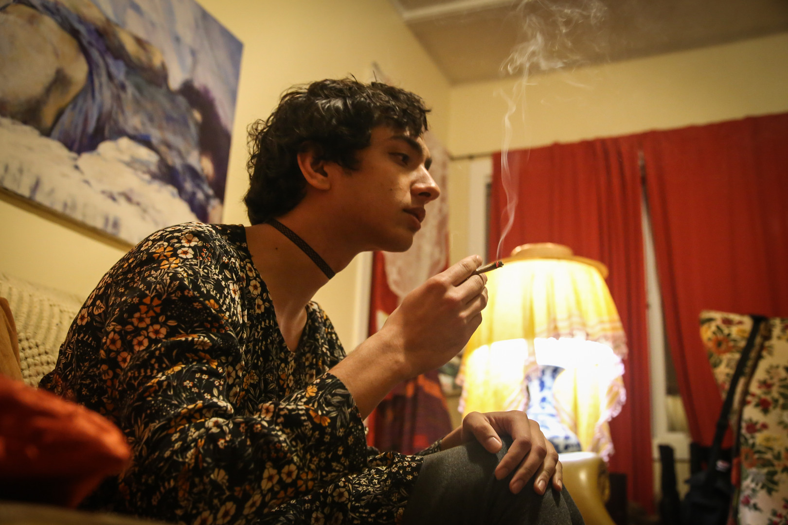 Strege unwinds after his day by smoking a joint in his home in San Francisco, Calif. on Apr. 3. (Photo: Adelyna Tirado)