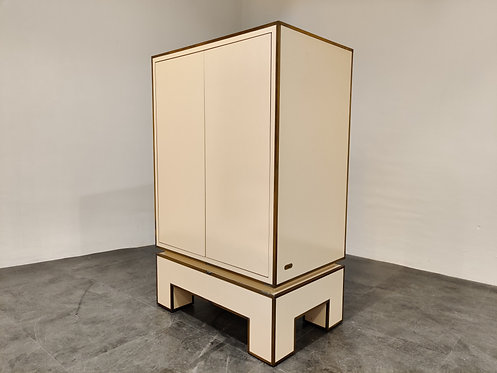 SOLD White lacquered cabinet by Alain Delon, 1970s