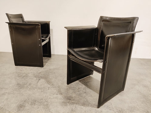 SOLD Pair of Tito Agnoli leather side chairs for Matteo Grassi, 1970s