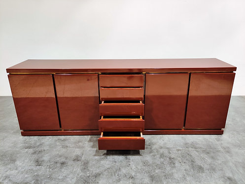 SOLD Red lacquered credenza by Jean Charles, 1970s