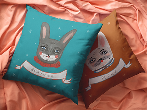 pair-of-pillows-lying-on-a-coral-silk-be
