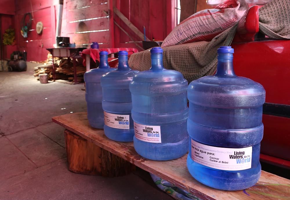 Bottles of clean water in the Villatoro home
