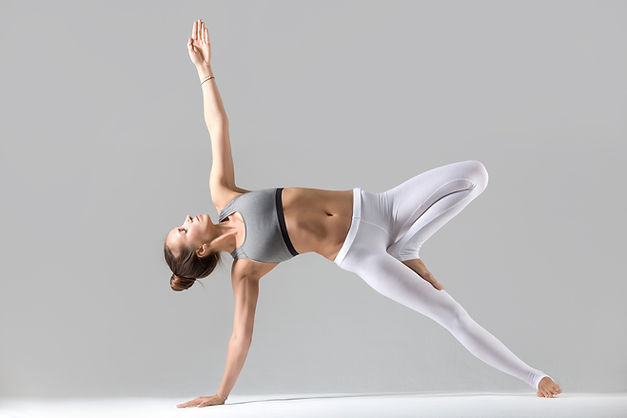young-woman-in-side-plank-pose-grey-stud