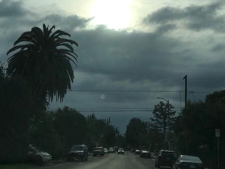 Clouds hide moon in rainy LA