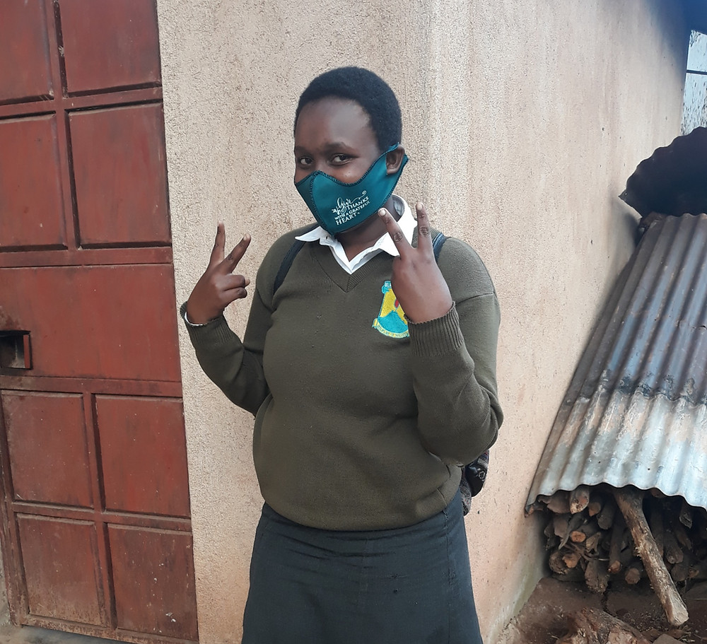 Girls to Girls scholarship recipient wearing a mask