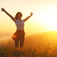 Happy woman   on the sunset in nature in summer with open hands__edited.jpg
